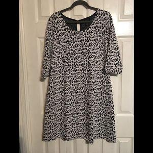 Black and white leopard stretch babydoll dress